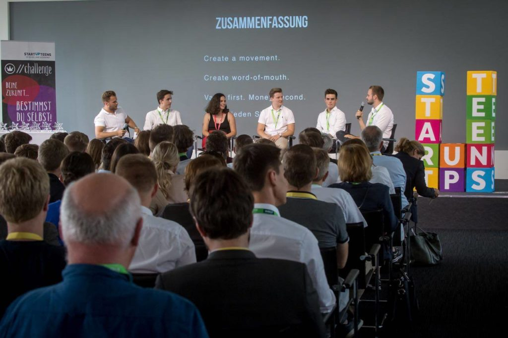 STARTUP TEENS present their business ideas on stage to an audience