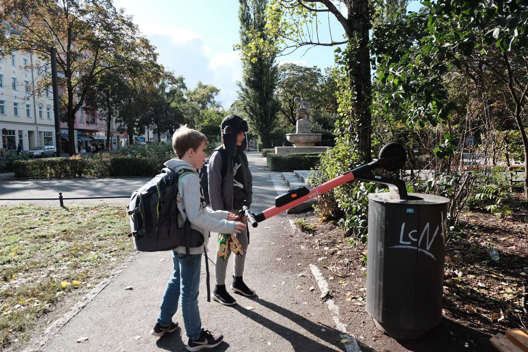 Kids disposing of an e-scooter